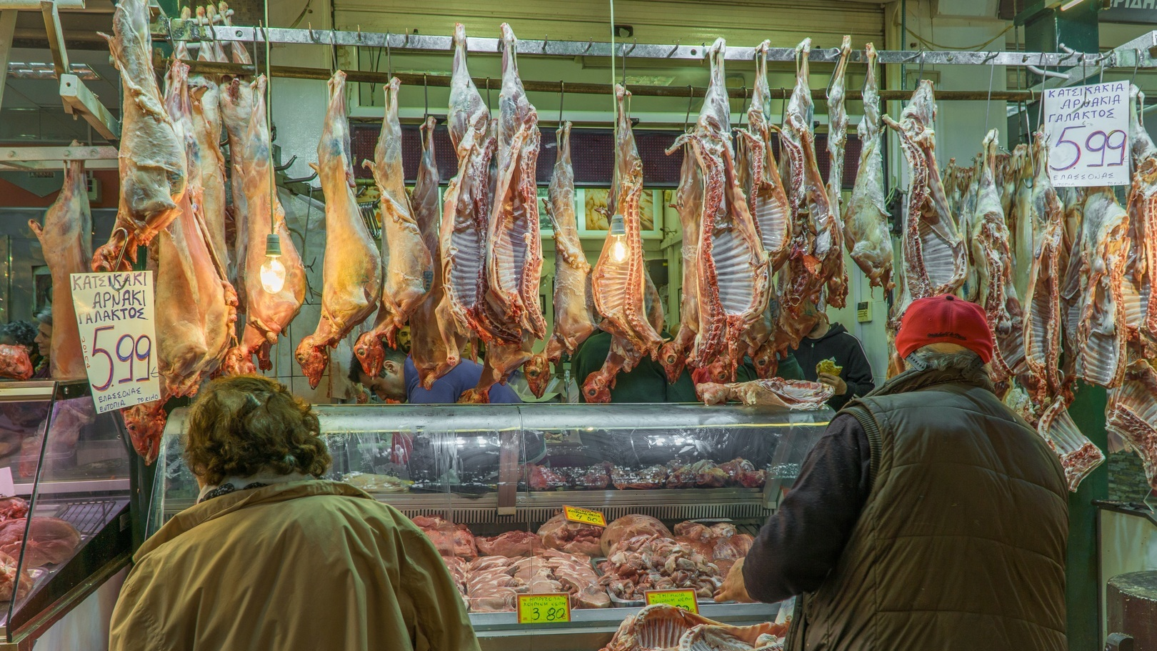 Butcher customers goat meat market market hall meat market 1366425 pxhere.com